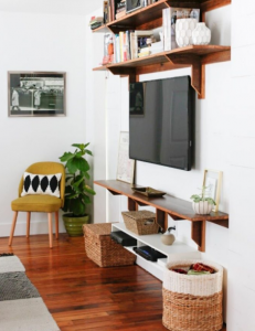 Integrate the television into the decoration with shelves